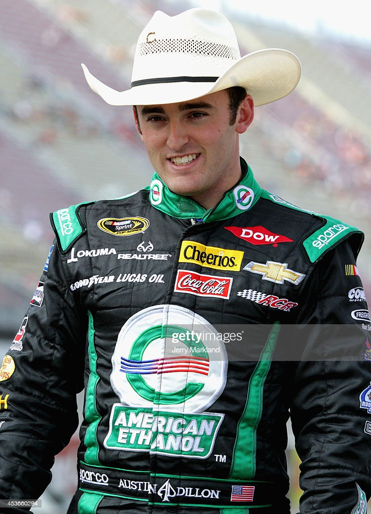 Austin Dillon, driver of the #3 American Ethanol Chevrolet, stands on the grid during qualifying for the NASCAR Sprint Cup Series Pure Michigan 400 at Michigan International Speedway on August 15, 2014 in Brooklyn, Michigan.