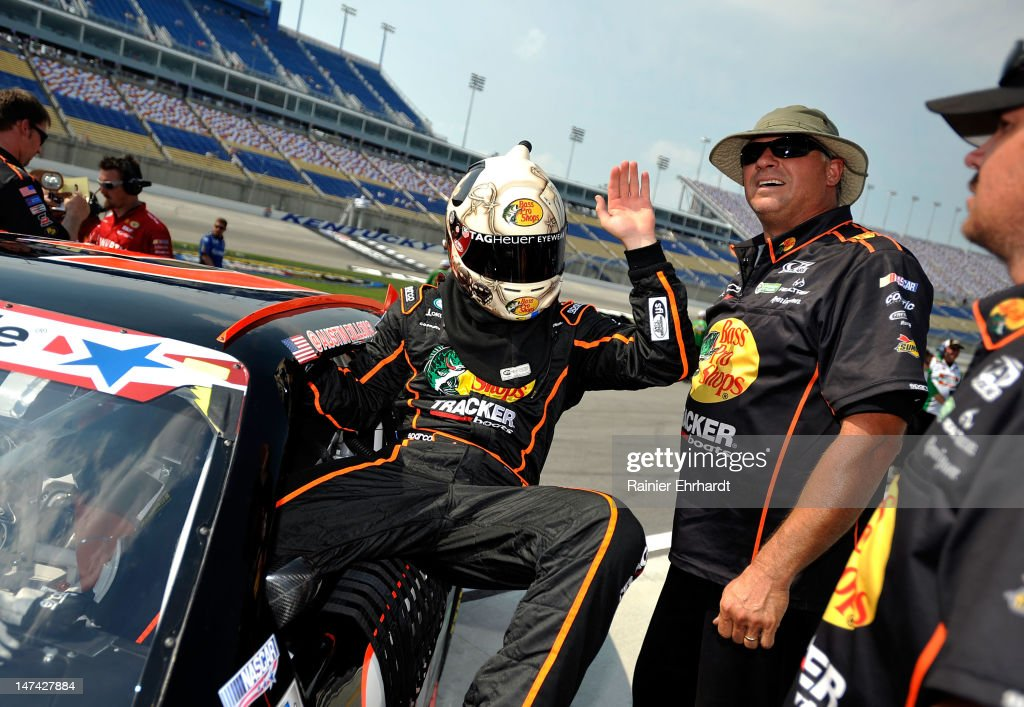<a gi-track='captionPersonalityLinkClicked' href=/galleries/search?phrase=Austin+Dillon&family=editorial&specificpeople=5075945 ng-click='$event.stopPropagation()'>Austin Dillon</a>, driver of the #3 Bass Pro Shops Chevrolet Chevrolet, climbs out of his car during qualifying for the NASCAR Nationwide Series Feed The Children 300 at Kentucky Speedway on June 29, 2012 in Sparta, Kentucky.