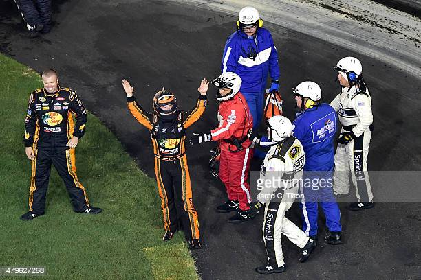 Austin Dillon driver of the Bass Pro Shops Chevrolet gestures to the crowd after being involved in an ontrack incident during the NASCAR Sprint Cup...