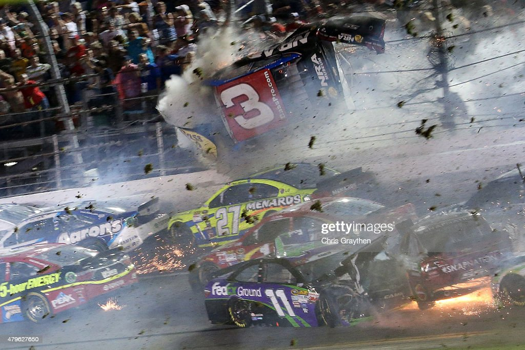 <a gi-track='captionPersonalityLinkClicked' href=/galleries/search?phrase=Austin+Dillon&family=editorial&specificpeople=5075945 ng-click='$event.stopPropagation()'>Austin Dillon</a>, driver of the #3 Bass Pro Shops Chevrolet, is involved in an on-track incident following the checkered flag during the NASCAR Sprint Cup Series Coke Zero 400 Powered by Coca-Cola at Daytona International Speedway on July 6, 2015 in Daytona Beach, Florida.