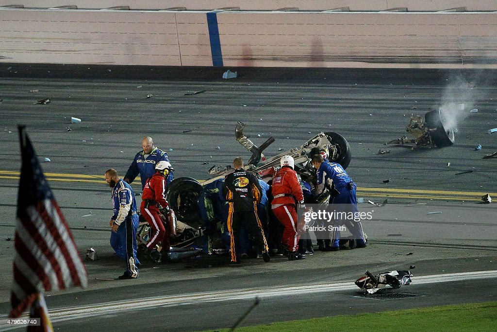 Austin Dillon driver of the Bass Pro Shops Chevrolet receives medical attention after a crash following the checkered flag during the NASCAR Sprint...