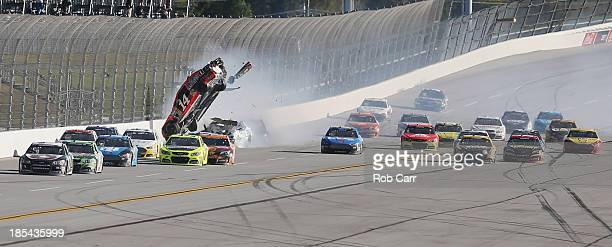 Austin Dillon driver of the Bass Pro Shops / Mobil 1 Chevrolet and Casey Mears driver of the GEICO Ford are involved in an incident during the NASCAR...
