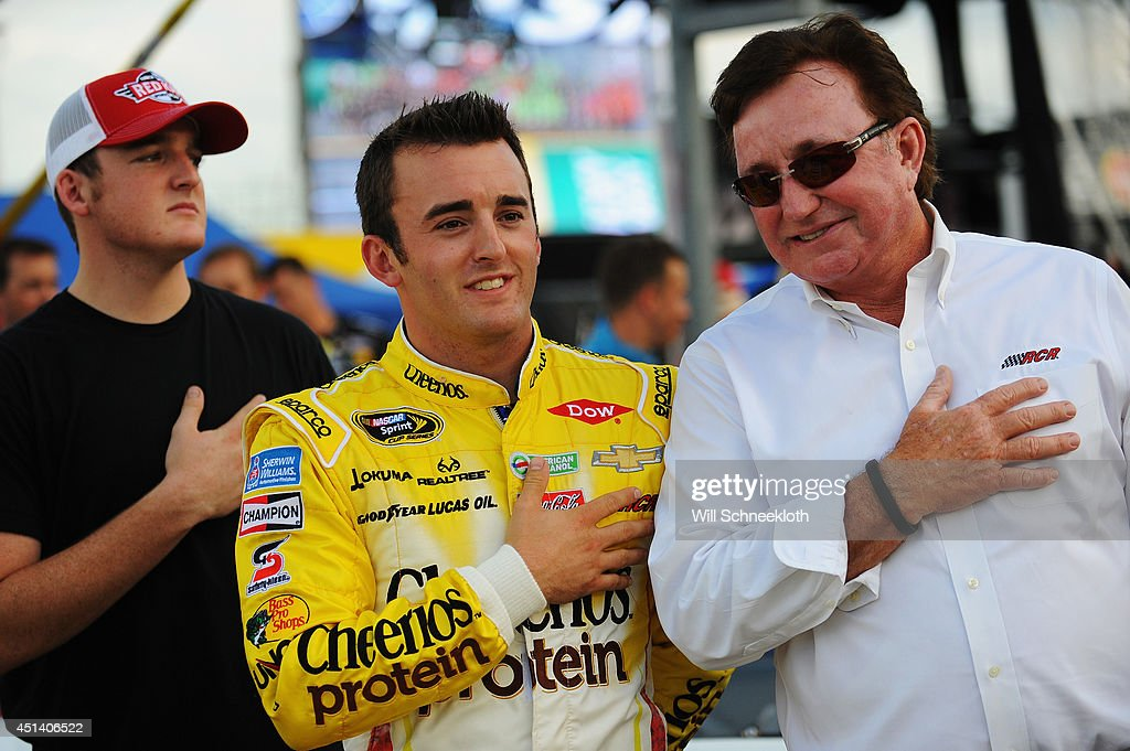 Austin Dillon driver of the Cheerios Protein Chevrolet center takes part in prerace ceremonies with team owner and grandfather Richard Childress...