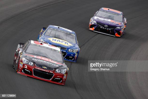 Austin Dillon driver of the Dow Automotive Magna Chevrolet leads a pack of cars during the Monster Energy NASCAR Cup Series Pure Michigan 400 at...