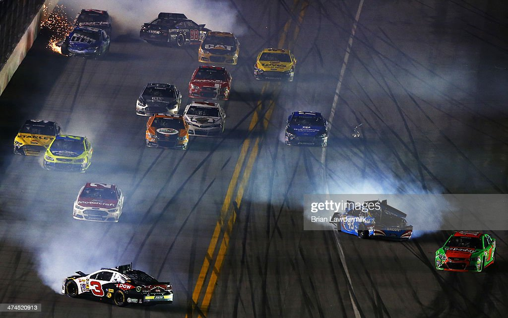 Austin Dillon driver of the DOW Chevrolet Aric Almirola driver of the Smithfield Ford and others are involved in an incident during the NASCAR Sprint...