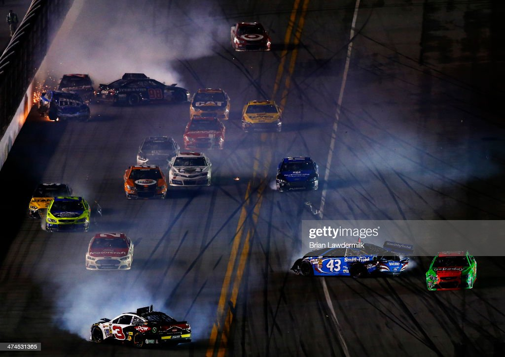 <a gi-track='captionPersonalityLinkClicked' href=/galleries/search?phrase=Austin+Dillon&family=editorial&specificpeople=5075945 ng-click='$event.stopPropagation()'>Austin Dillon</a>, driver of the #3 DOW Chevrolet, <a gi-track='captionPersonalityLinkClicked' href=/galleries/search?phrase=Aric+Almirola&family=editorial&specificpeople=574878 ng-click='$event.stopPropagation()'>Aric Almirola</a>, driver of the #43 Smithfield Ford, and others are involved in an incident during the NASCAR Sprint Cup Series Daytona 500 at Daytona International Speedway on February 23, 2014 in Daytona Beach, Florida.