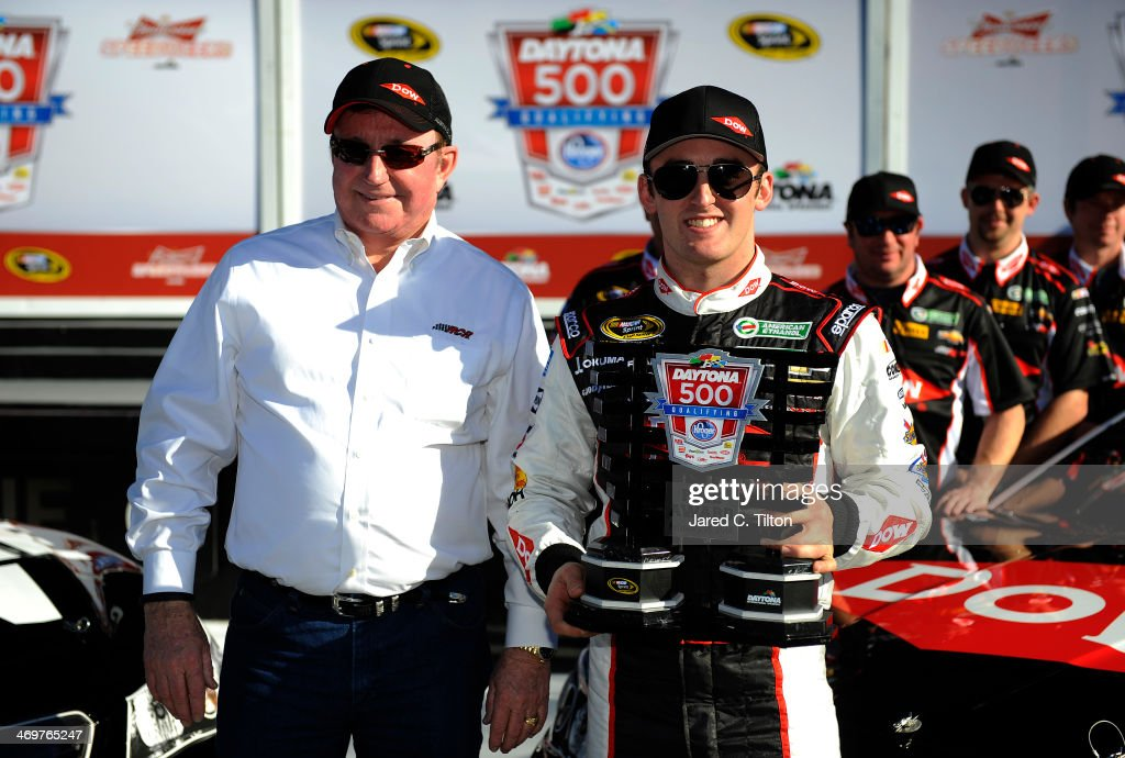 Austin Dillon driver of the DOW Chevrolet celebrates in Victory Lane with team owner Richard Childress after winning pole position for the NASCAR...