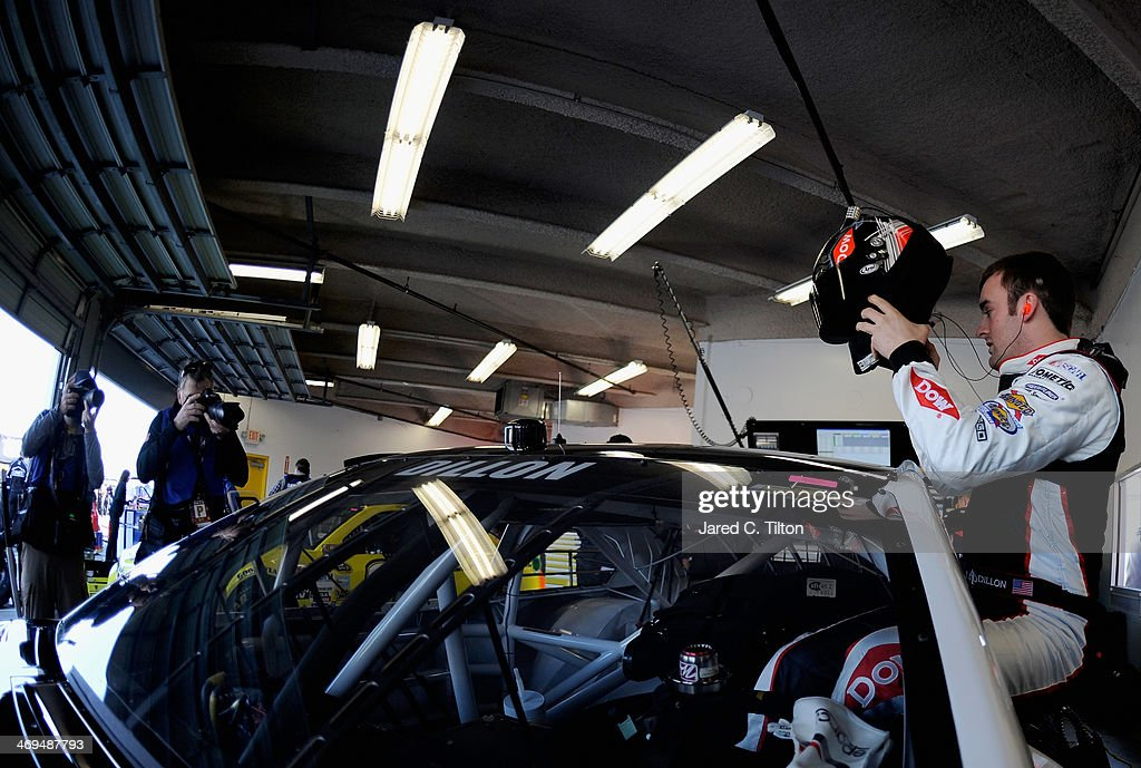 <a gi-track='captionPersonalityLinkClicked' href=/galleries/search?phrase=Austin+Dillon&family=editorial&specificpeople=5075945 ng-click='$event.stopPropagation()'>Austin Dillon</a>, driver of the #3 DOW Chevrolet, climbs in his car in the garage area during practice for the NASCAR Sprint Cup Series Daytona 500 at Daytona International Speedway on February 15, 2014 in Daytona Beach, Florida.