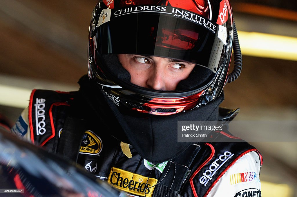 Austin Dillon, driver of the #3 Dow Chevrolet, climbs into his car in the garage area during practice for the NASCAR Sprint Cup Series Quicken Loans 400 at Michigan International Speedway on June 14, 2014 in Brooklyn, Michigan.