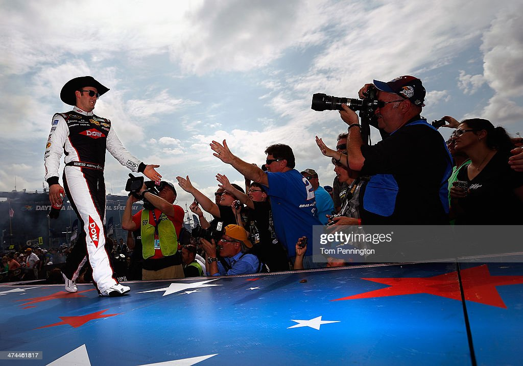 <a gi-track='captionPersonalityLinkClicked' href=/galleries/search?phrase=Austin+Dillon&family=editorial&specificpeople=5075945 ng-click='$event.stopPropagation()'>Austin Dillon</a>, driver of the #3 DOW Chevrolet, is introdcued during pre-race ceremonies for the NASCAR Sprint Cup Series Daytona 500 at Daytona International Speedway on February 23, 2014 in Daytona Beach, Florida.