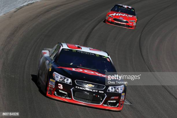 Austin Dillon driver of the DOW Chevrolet leads Kurt Busch driver of the Haas Automation/Monster Energy Ford during the Monster Energy NASCAR Cup...