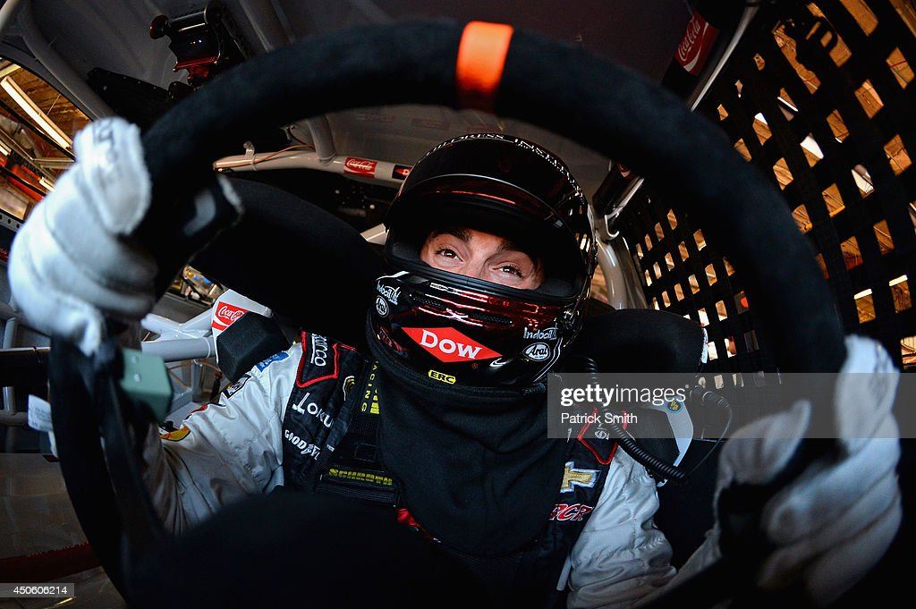 Austin Dillon, driver of the #3 Dow Chevrolet, sits in his car in the garage area during practice for the NASCAR Sprint Cup Series Quicken Loans 400 at Michigan International Speedway on June 14, 2014 in Brooklyn, Michigan.