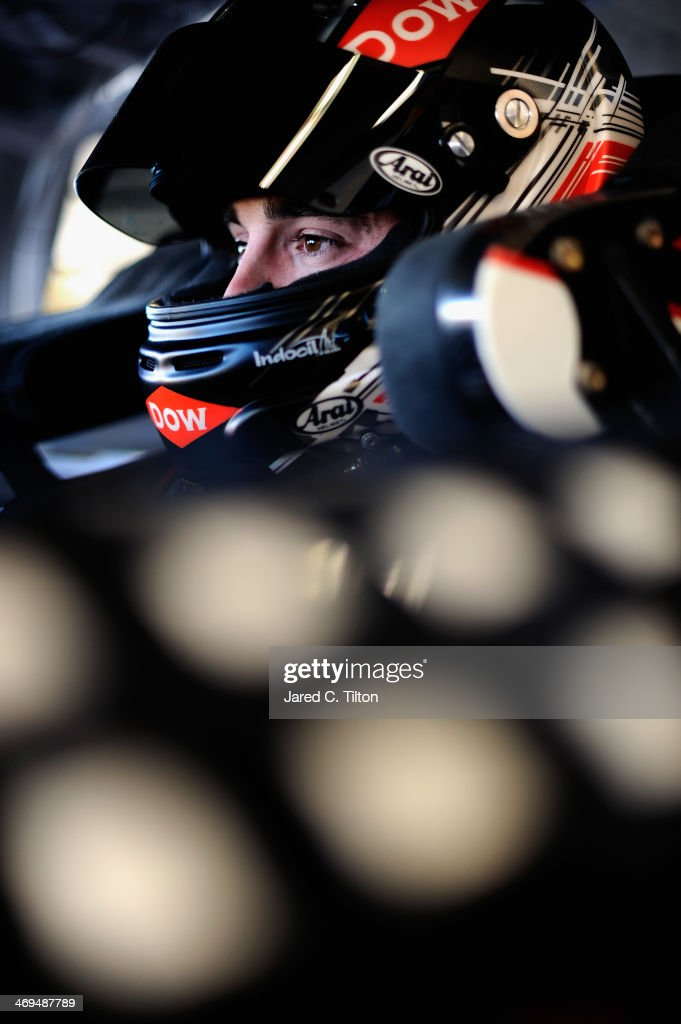 <a gi-track='captionPersonalityLinkClicked' href=/galleries/search?phrase=Austin+Dillon&family=editorial&specificpeople=5075945 ng-click='$event.stopPropagation()'>Austin Dillon</a>, driver of the #3 DOW Chevrolet, sits in his car in the garage area during practice for the NASCAR Sprint Cup Series Daytona 500 at Daytona International Speedway on February 15, 2014 in Daytona Beach, Florida.