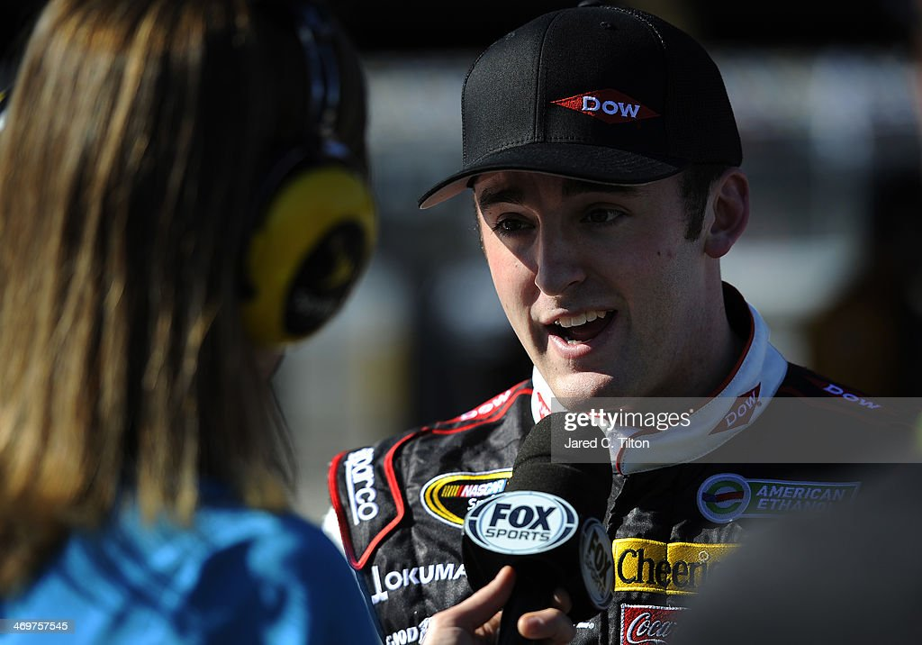 Austin Dillon driver of the DOW Chevrolet speaks to the media after qualifying for the NASCAR Sprint Cup Series Daytona 500 at Daytona International...