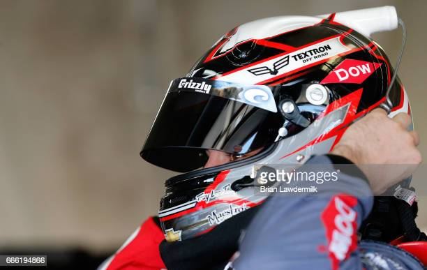 Austin Dillon driver of the DOW Energy Water Chevrolet stands in the garage area during practice for the Monster Energy NASCAR Cup Series O'Reilly...