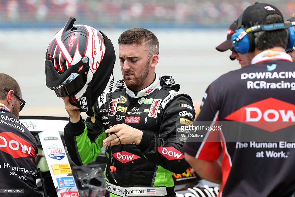 Austin Dillon, driver of the #3 Dow - Energy & Water/Intellifresh Chevrolet, stands on the grid during qualifying for the NASCAR Sprint Cup Series GEICO 500 at Talladega Superspeedway on April 30, 2016 in Talladega, Alabama.