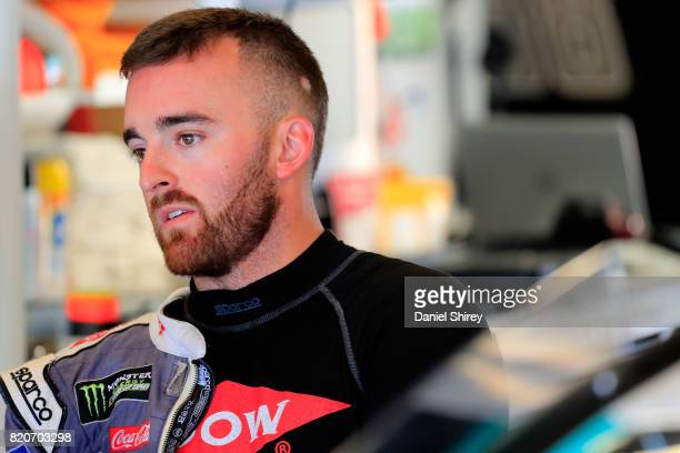Austin Dillon driver of the Dow Molykote Smart Lubrication Chevrolet stands in the garage area during practice for the Monster Energy NASCAR Cup...
