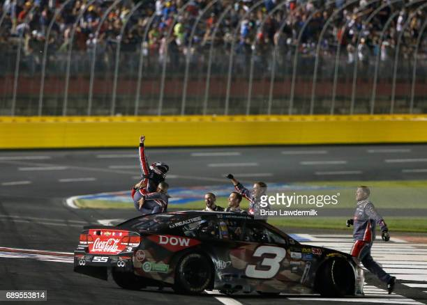 Austin Dillon driver of the DOW Salutes Veterans Chevrolet celebrates with his crew after winning the Monster Energy NASCAR Cup Series CocaCola 600...