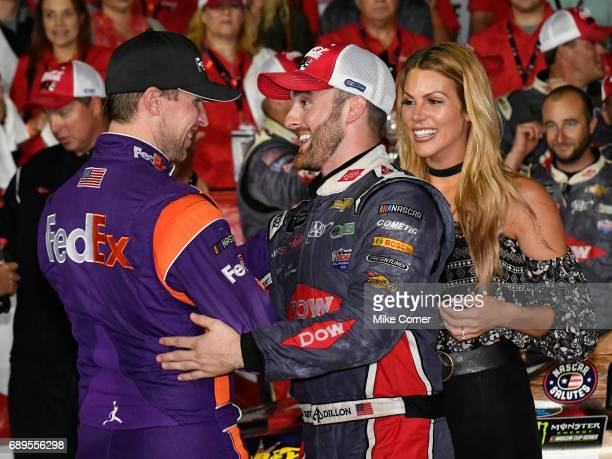 Austin Dillon driver of the DOW Salutes Veterans Chevrolet celebrates with Denny Hamlin driver of the FedEx Office Toyota after winning the Monster...
