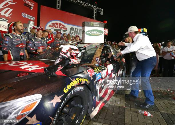 Austin Dillon driver of the DOW Salutes Veterans Chevrolet celebrates with team owner Richard Childress after winning the Monster Energy NASCAR Cup...