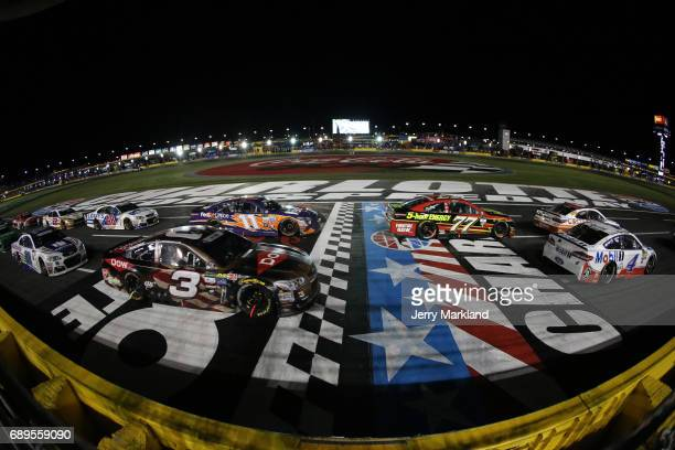 Austin Dillon driver of the DOW Salutes Veterans Chevrolet races during the Monster Energy NASCAR Cup Series CocaCola 600 at Charlotte Motor Speedway...