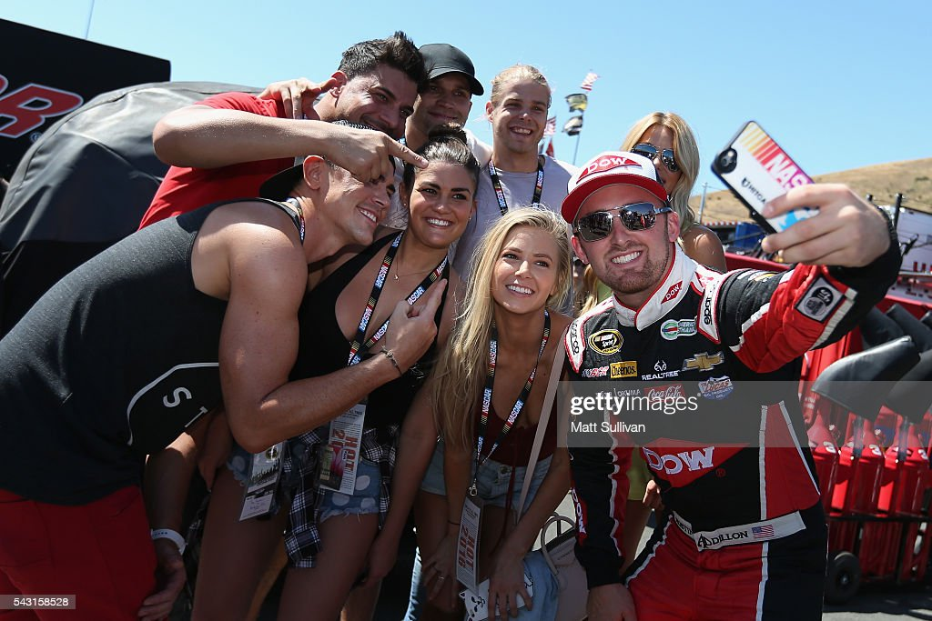 Austin Dillon, driver of the #3 Dow/Utility Trailers Chevrolet, takes a photo with cast members from reality TV show Vanderpump Rules prior to the NASCAR Sprint Cup Series Toyota/Save Mart 350 at Sonoma Raceway on June 26, 2016 in Sonoma, California.