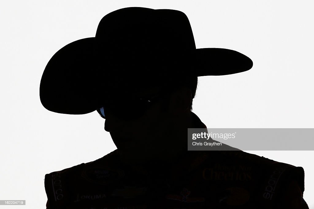 Austin Dillon, driver of the #33 Honey Nut Cheerios Chevrolet, stands in the garage during practice for the NASCAR Sprint Cup Series Daytona 500 at Daytona International Speedway on February 20, 2013 in Daytona Beach, Florida.