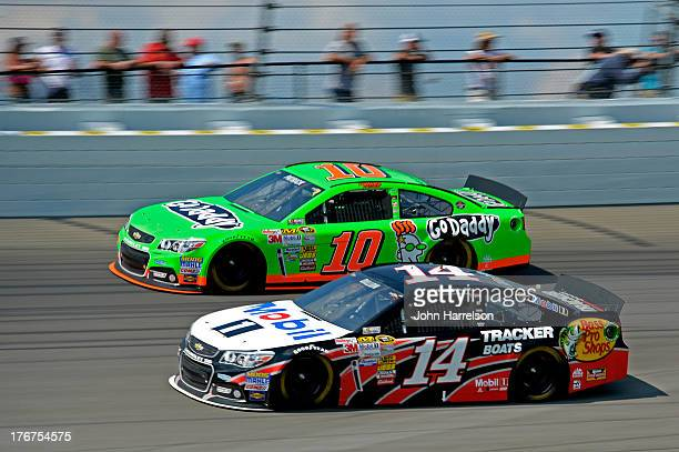 Austin Dillon driver of the Mobil 1 / Bass Pro Shops Chevrolet races Danica Patrick driver of the GoDaddy Chevrolet during the NASCAR Sprint Cup...