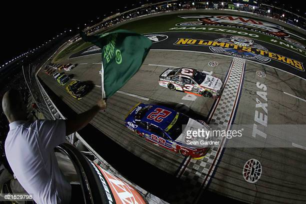 Austin Dillon driver of the Realtree/Bad Boy Chevrolet and Joey Logano driver of the AAA Ford lead the field past the green flag during the NASCAR...
