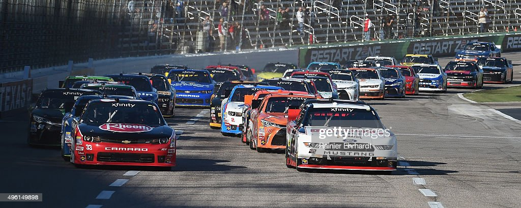 Austin Dillon driver of the Rheem Chevrolet and Brad Keselowski driver of the Discount Tire Ford lead the field at the start of the NASCAR XFINITY...