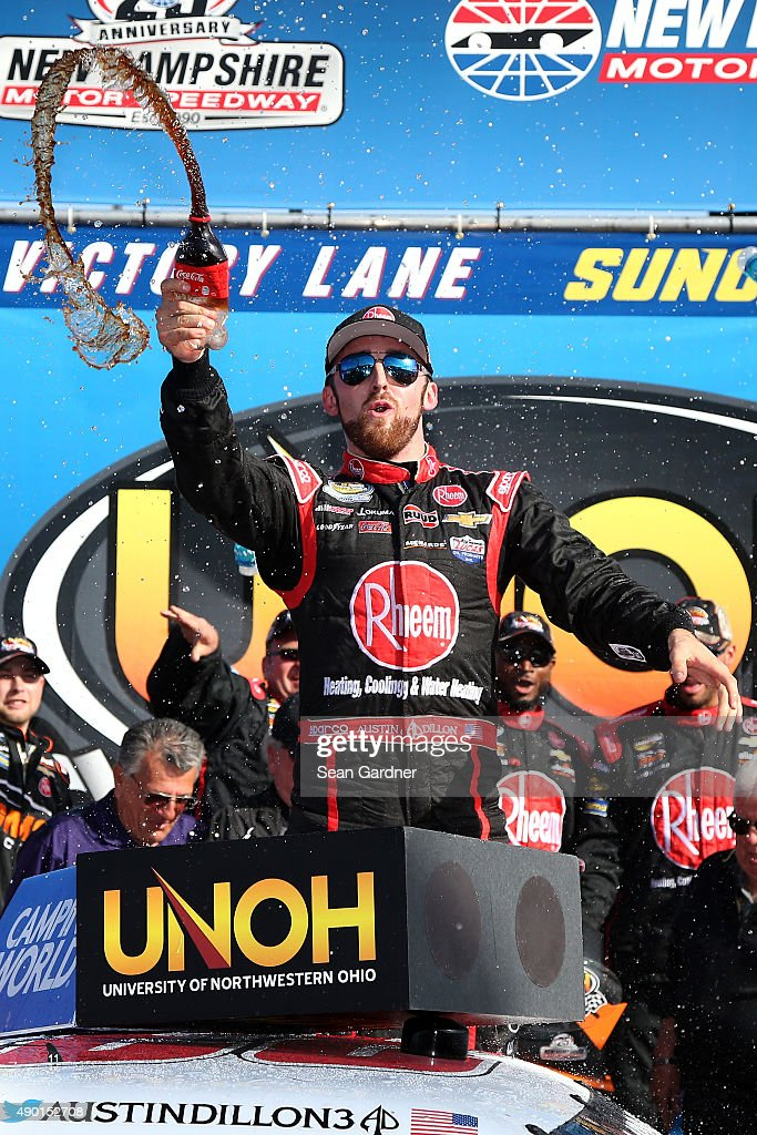 Austin Dillon driver of the Rheem Chevrolet celebrates in Victory Lane after winning the NASCAR Camping World Truck Series UNOH 175 at New Hampshire...