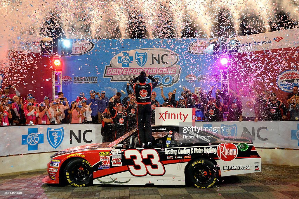 Austin Dillon driver of the Rheem Chevrolet celebrates in victory lane after winning the NASCAR XFINITY Series Drive for the Cure 300 at Charlotte...
