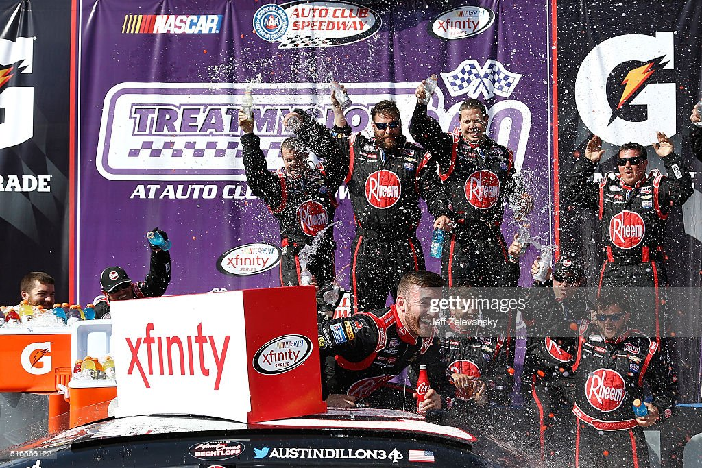 Austin Dillon driver of the Rheem Chevrolet celebrates in victory lane after winning the NASCAR Xfinity Series TreatMyClotcom 300 at Auto Club...