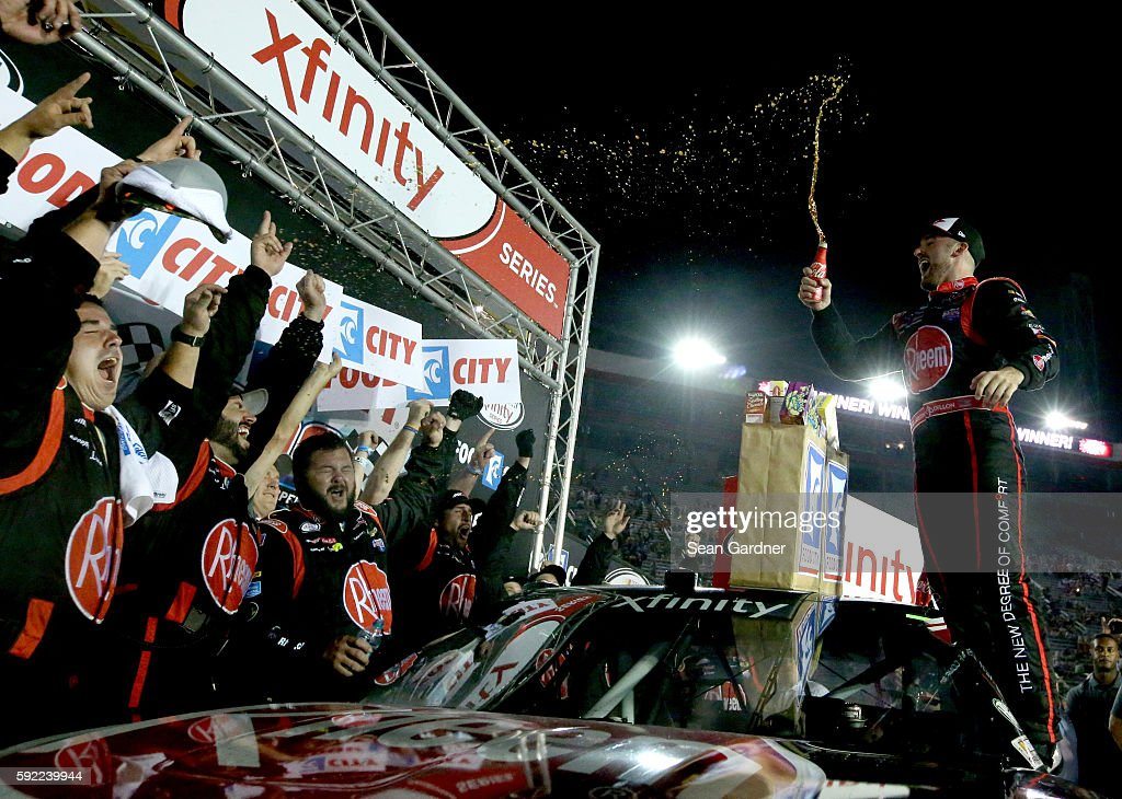Austin Dillon driver of the Rheem Chevrolet celebrates with his team in Victory Lane after winning the NASCAR XFINITY Series Food City 300 at Bristol...
