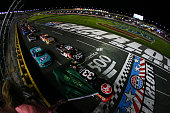 Austin Dillon driver of the Rheem Chevrolet leads the field past the green flag to start the NASCAR XFINITY Series Drive for the Cure 300 at...