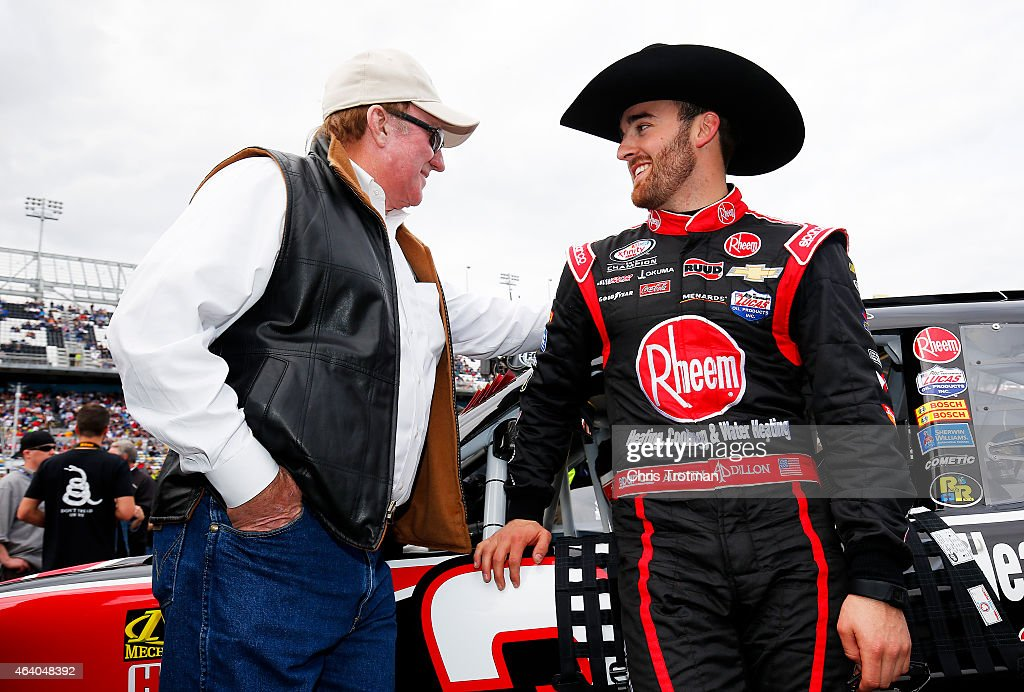 Austin Dillon driver of the Rheem Chevrolet right talks with grandfather and team owner Richard Childress during prerace ceremonies for the NASCAR...