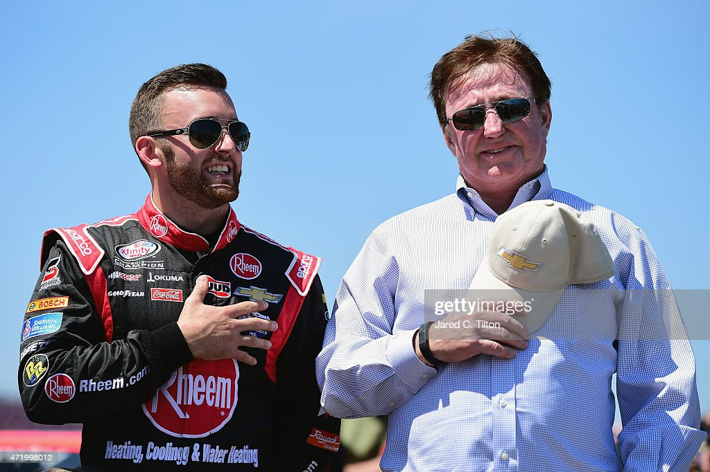 Austin Dillon driver of the Rheem Chevrolet stands on the grid with team owner Richard Childress prior to the NASCAR XFINITY Series Winn Dixie 300 at...