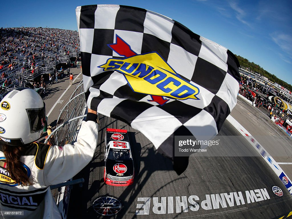 Austin Dillon driver of the Rheem Chevrolet takes the checkered flag to win the NASCAR Camping World Truck Series UNOH 175 at New Hampshire Motor...