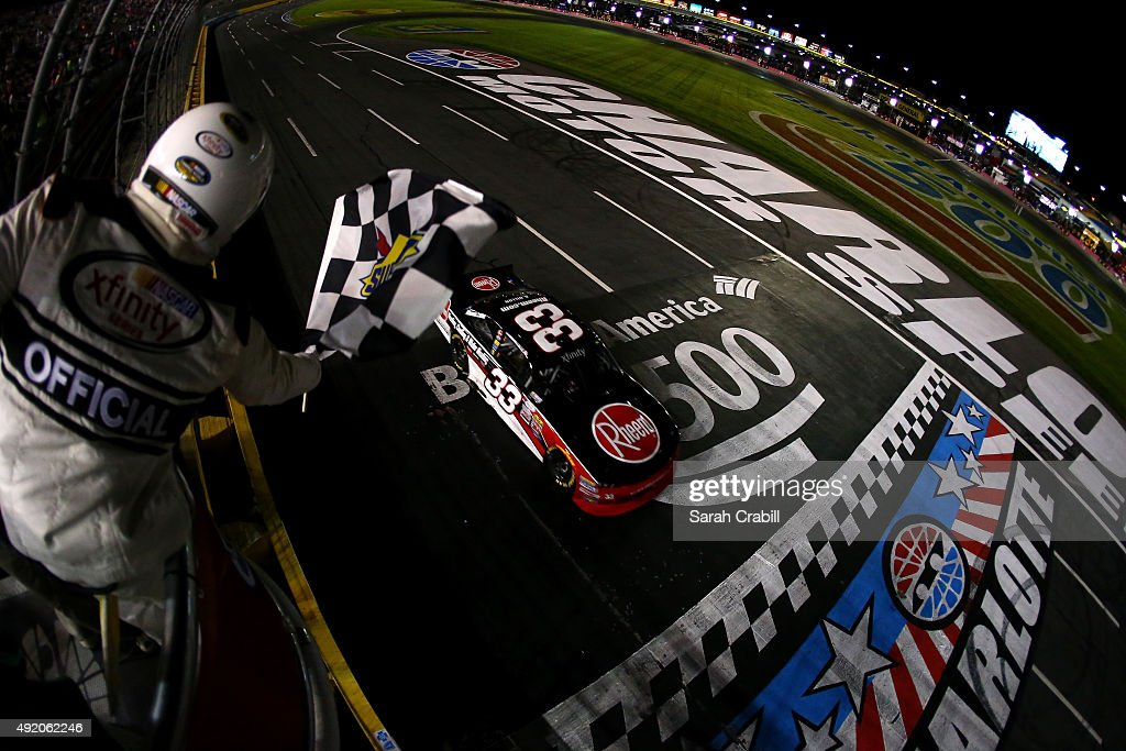 Austin Dillon driver of the Rheem Chevrolet takes the checkered flag to win the NASCAR XFINITY Series Drive for the Cure 300 at Charlotte Motor...