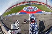 Austin Dillon driver of the Rheem Chevrolet takes the checkered flag to win the NASCAR Xfinity Series TreatMyClotcom 300 at Auto Club Speedway on...