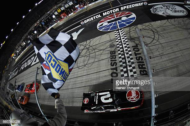 Austin Dillon driver of the Rheem Chevrolet takes the checkered flag during the NASCAR XFINITY Series Food City 300 at Bristol Motor Speedway on...