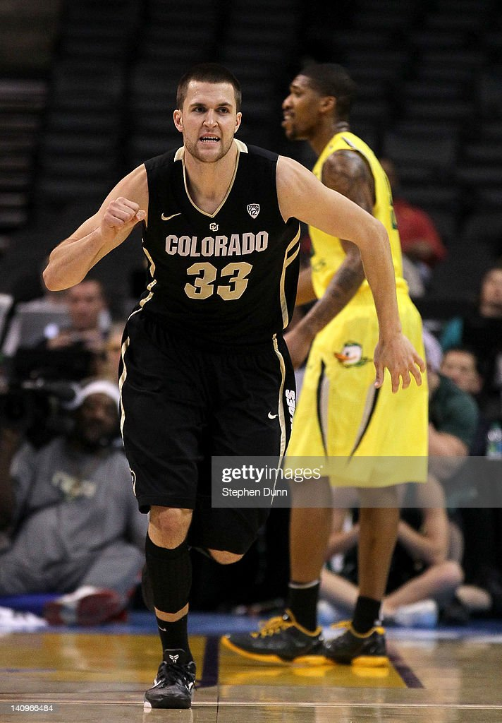 Austin Dufault #33 of the Colorado Buffaloes celebrates after the game against the Oregon Ducks during the quarterfinals of the Pac12 Men's Basketball Tournament at Staples Center on March 8, 2012 in Los Angeles, California. Colorado won 63-62.