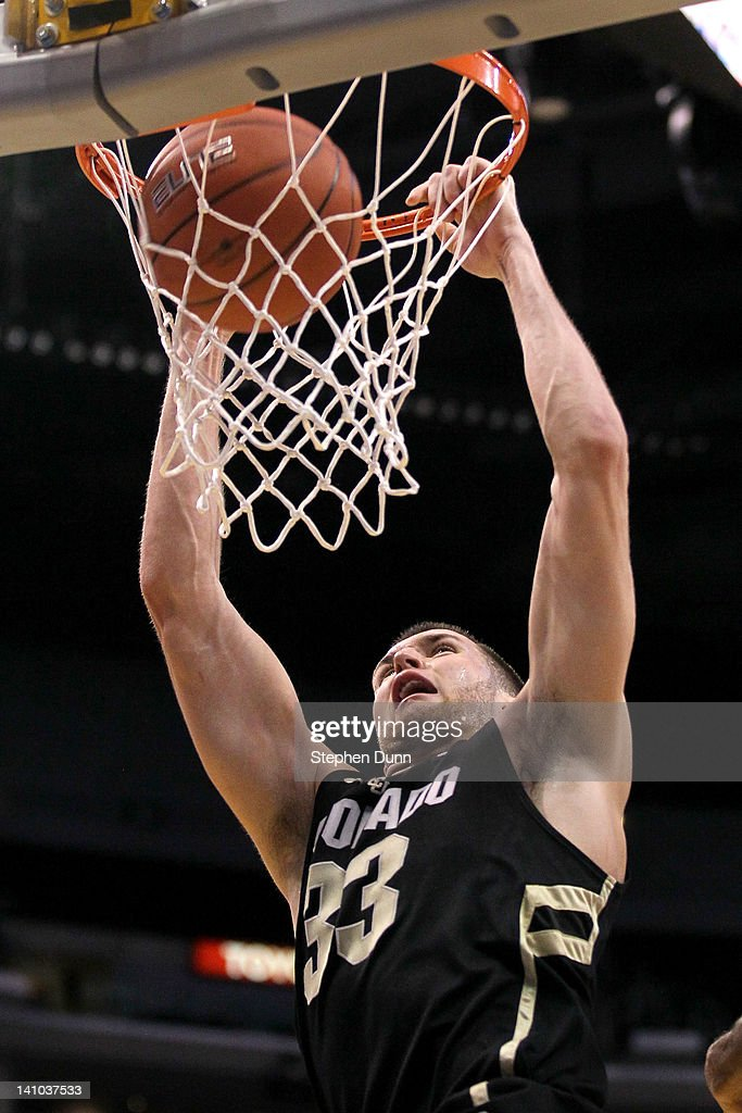 Austin Dufault #33 of the Colorado Buffaloes dunks the ball in the first half against the California Golden Bears in the semifinals of the 2012 Pacific Life Pac-12 men's basketball tournament at Staples Center on March 9, 2012 in Los Angeles, California.
