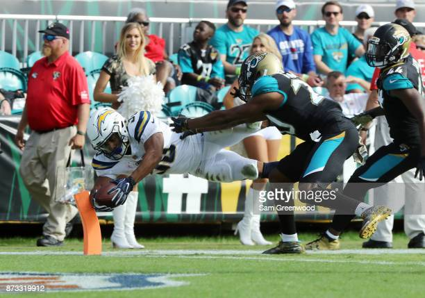 Austin Ekeler of the Los Angeles Chargers beats Jalen Ramsey of the Jacksonville Jaguars for a 22yard touchdown in the second half of their game at...