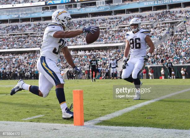 Austin Ekeler of the Los Angeles Chargers celebrates a 28yard touchdown in the first half of their game against the Jacksonville Jaguars at EverBank...