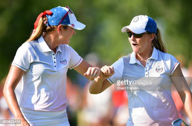 Austin Ernst of Team USA celebrates chipping in on the 15th hole with Paula Creamer during the second day afternoon fourball matches of The Solheim...
