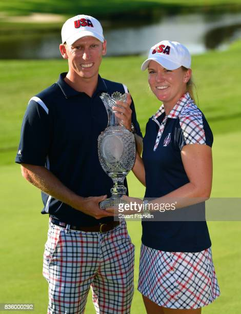Austin Ernst of Team USA holds the Solheim Cup trophy after the final day singles matches of The Solheim Cup at Des Moines Golf and Country Club on...