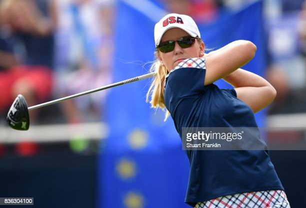 Austin Ernst of Team USA plays a shot on the 18th hole during the final day singles matches of The Solheim Cup at Des Moines Golf and Country Club on...