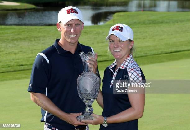 Austin Ernst of the United States Team holds the Solheim Cup with her brother and caddie Drew Ernst after the closing ceremony during the final day...