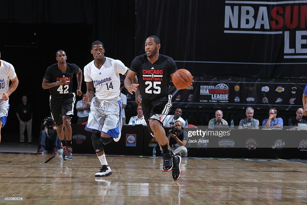 Austin Freeman of the Chicago Bulls dribbles the ball against the Los Angeles Clippers during the game at the Samsung NBA Summer League 2014 at the...